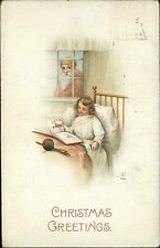 CHRISTMAS Santa Claus Watches Girl Read Picture Book in Bed c1910 Postcard