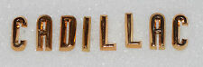 1957 CADILLAC TRUNK LETTER SET - GOLD - NEW GM