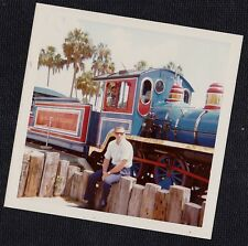 Vintage Photograph Man Sitting on Fence By Cute Colorful Train Railway 1976