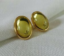 Goldtone and vaseline yellow cabochon oval pierced stud earrings signed Trifari