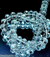 A string of faceted crystal beads, flat round,  8 mm & 10 mm in various colours
