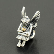 Genuine solid silver fairy pixie with gold heart charm