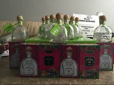 Case Of 12 Patron Silver Empty 750mL Bottles With Tags And Corks.