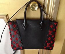 Louis Vuittons Authentic handbag, black with red monogram, made in France