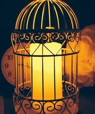 Flameless candle in bird cage