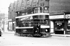 a0224 - Leeds Tram no 197 to Elland Rd by Butchers Shop , Yorkshire - photograph