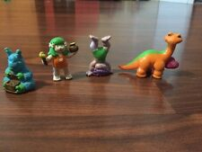 "1986 McDonalds Tinosaurs Lot of 4 2"" Tall Dinosaurs Prehistoric PVC Boy Girl"