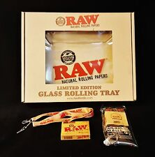 1 Raw Rolling Papers Glass Tray, 1 Deck Playing Cards, 1 Lanyard, & 1 Bandanna
