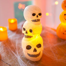 Stack of Battery Operated Wax LED Halloween Skulls Table Party Decoration