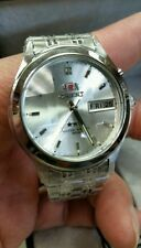 50MM ORIENT MEN' AUTOMATIC WATCH. 3 ***STAR.SILVER DIAL COLOR FECETED CRYSTAL.