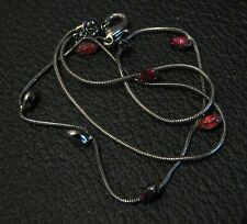 Great costume jewellery necklace in dark metal with small red stone decoration