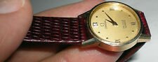 Omega solid 14K gold women's watch push button crownless beautiful runs nicely