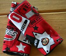 infant/toddler seat strap covers in red and black sports themed with black minky