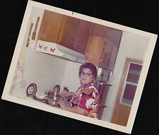 Old Vintage Photograph Woman in Retro Kitchen Cooking On the Stove