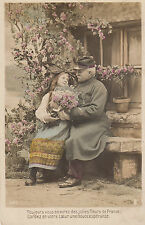CF03.Vintage French Postcard.Old Soldier and flower girl.