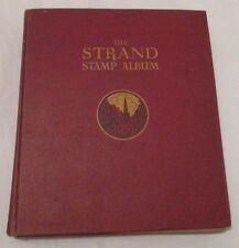 Old SG 'The Strand Stamp Album' with approximately 1700 used Worldwide Stamps