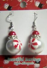 BEAUTIFUL EARRINGS MADE OUT OF RED AND WHITE PEARL-LIKE BEADS AND CRYSTALS