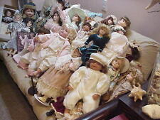 50+ COLLECTIBLE DOLLS IN PERIOD DRESS, IN PORCELAIN.