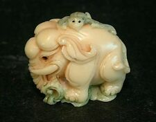 Vintage Japanese ivory colored  netsuke -Baby Elephant with Bat on green grass