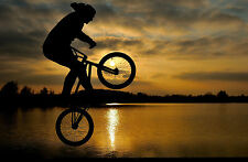 Framed Print - BMX Stunts Next to a Lake at Sunset (Bike Picture Poster Art)