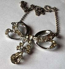 silver tone clear crystal bow necklace