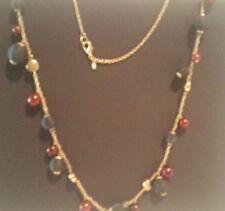 Long Black and Red Bead Necklace with Gold Tone Chain and accents. Marked PD