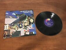 The Moody Blues record - Caught Live + 5 previously unreleased studio recordings