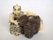 Japanese ivory color bone netsuke -Street Peddler sell Daruma Mask from basket
