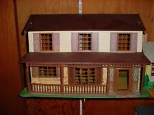 TIN LITHO / PLASTIC 2 STORY  DOLL HOUSE WITH A NICE FRONT PORCH