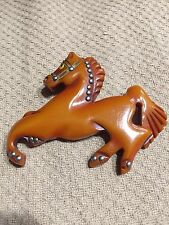 Antique Bakelite horse brooch