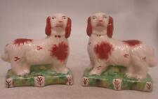 Staffordshire Pottery Pair of Figures - Standing Dogs on Green Bases