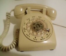 ITT     beige   rotary phone      i have a video of the phone showing it work