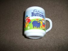 CADBURY'S BUTTONS DRINKING MUG-APPEARS NEW AND UNUSED-BY ARCOPAL, FRANCE-WHITE