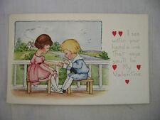 VINTAGE EMBOSSED VALENTINE'S POSTCARD BOY READING GIRL'S PALM IN COUNTRY SCENE