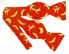 (1) BOW TIE- GO BANANAS! YELLOW BANANAS ON A RED BACKGROUND