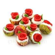 3 Miniature Red Fondant Rose Cupcakes With Red And Yellow Paper Cups