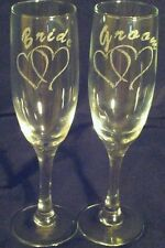 Bride and Groom laser engraved toasting glasses.