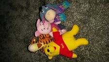 4 Winnie the Pooh soft toys - Pooh, Tiger, Piglet & Eeyore