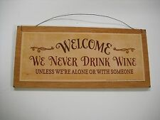 welcome we never drink wine unless were alone or with someone wooden bar sign