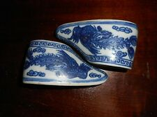 "A PAIR OF ""CURIO"" CHINESE BLUE AND WHITE EXPORT PORCELAIN BABY SHOES"