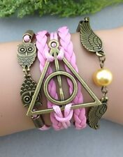 Bracelet Harry Potter rose couple de hiboux , triangle RDLM. le vif d'or. ailes