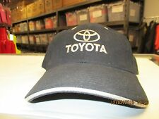 "TOYOTA-BLACK CAP W/ ""TOYOTA"" &  CO. LOGO IN ANTIQUE GOLD THREAD-METAL BUCKLE"
