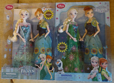 Both versions of Disney Store Frozen Fever Anna and Elsa Doll Sets