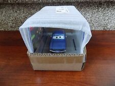Disney Cars 2 Brent Mustangburger sealed in unopened collector's display case