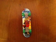 McDonald's Happy Meal Young Justice  Aqualad comic book hero green skateboard