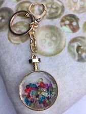 Stylish Glass Sphere Holding Multi Colored Loose Crystals Bag Charm/Keyring..!!