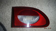 1997--2002 CHEV. CAVALIER L.H. TAIL LIGHT (INTSIDE) TRUNK  LID  MOUNTED