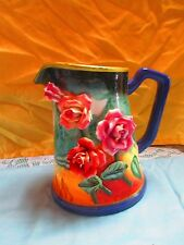 water  pitcher with raised flower design