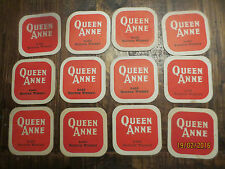 12 QUEEN ANNE early 1970,s SCOTCH WHISKY collectable COASTERS SQ.