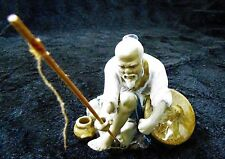 Very Detailed Figurine of a Chinese Fisherman.